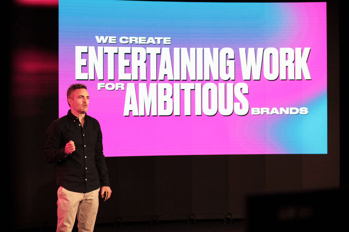 "Rory Hamilton presenting at IAPI event with slide reading ""We create entertaining work for ambitious brands"""