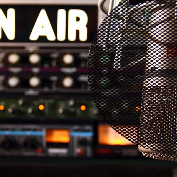 """On air"" sign and microphone"